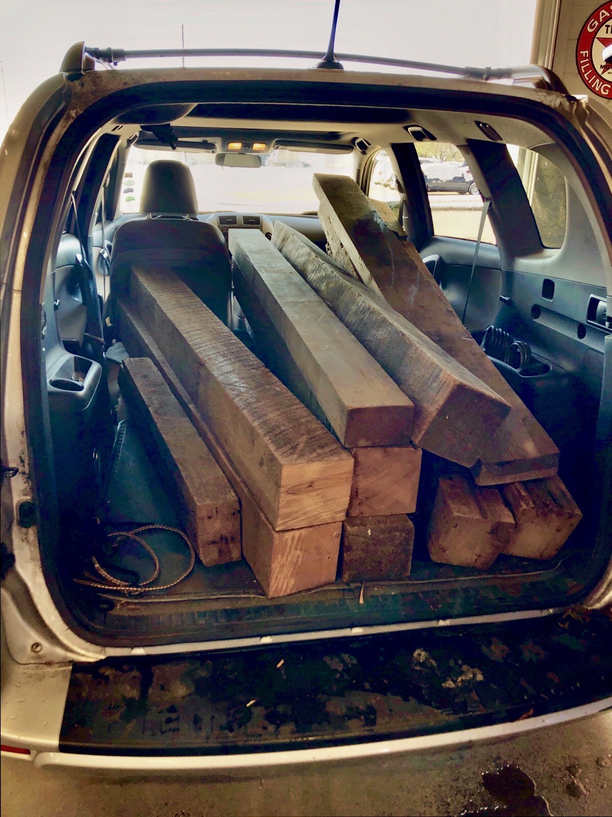 My car full of old barn beams.