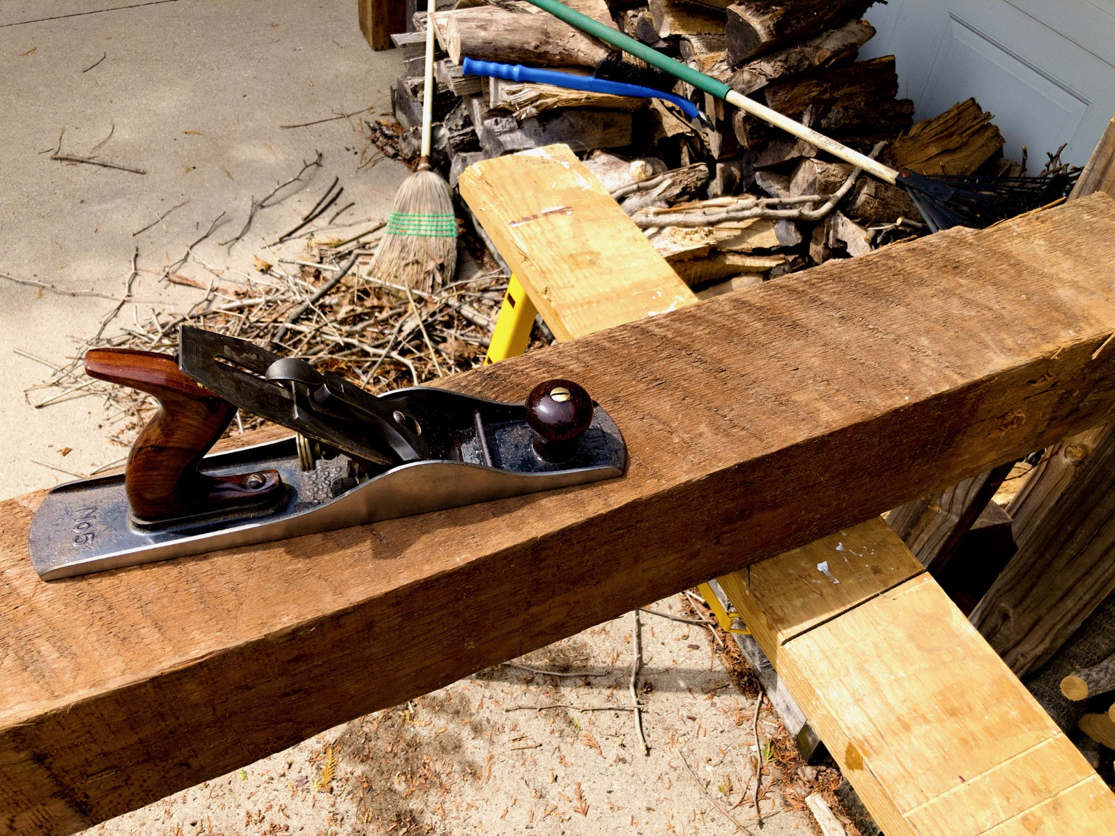 Close up of a barn beam and a handplane.