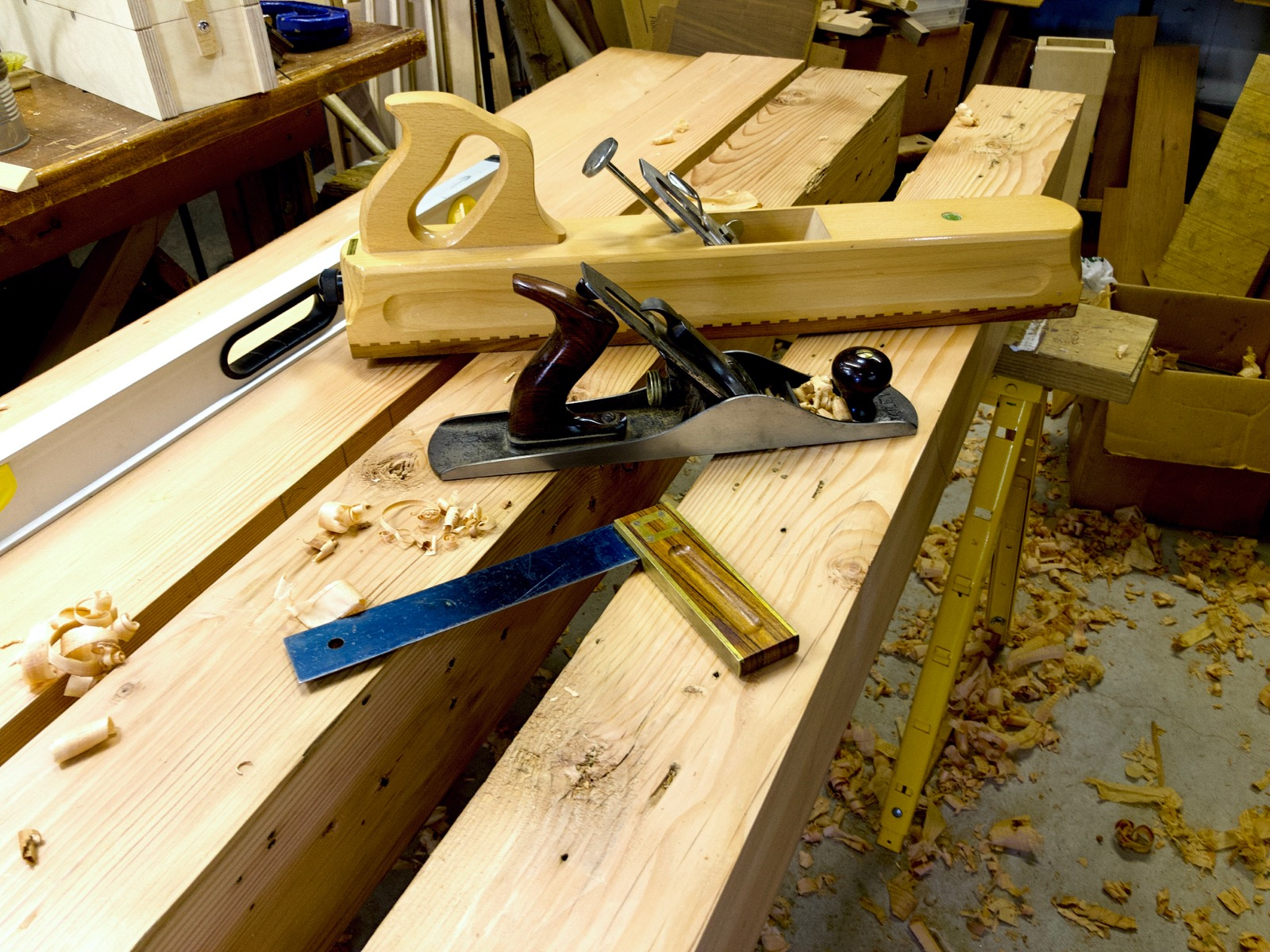 The beams for the top on a saw horse. Tools are on the beams.