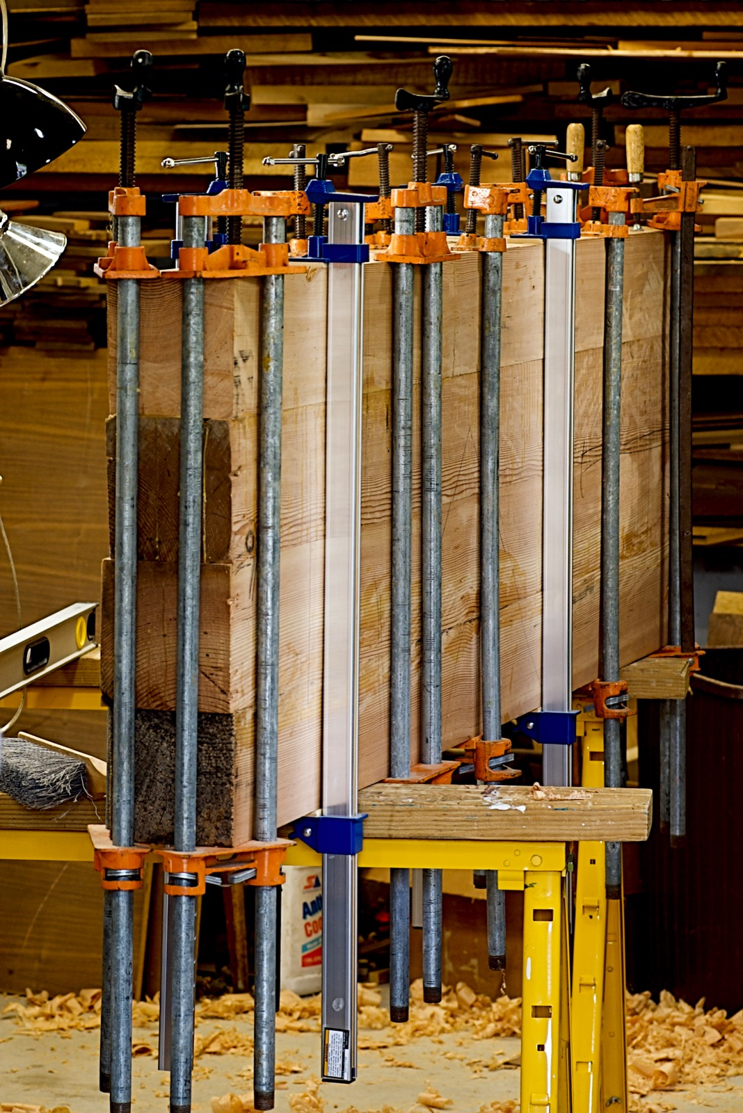 The full top of four beams in clamps.