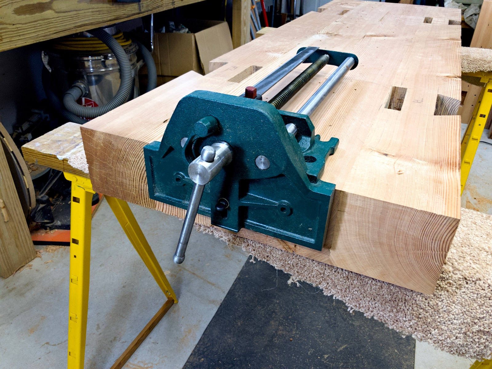 The quick vise sitting on the bench.