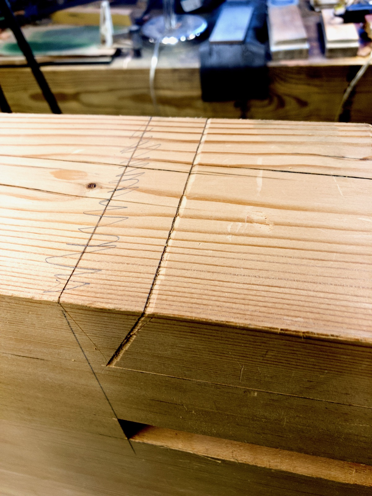 The knife walls cut into a leg for the sliding dovetails.