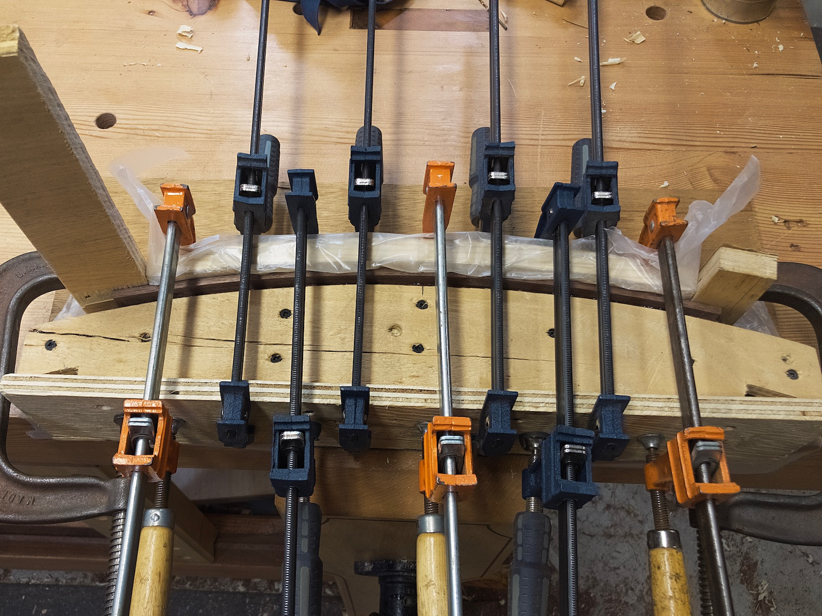 Curved drawer front in clamps
